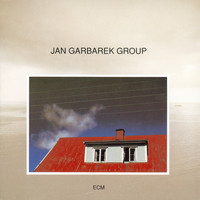 Jan Garbarek Group - Photo With Blue Sky, White Cloud, Wires, Windows And A Red R
