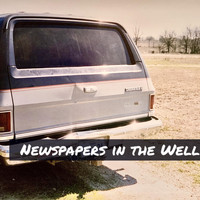 Why Coyote Why - Newspapers in the Well